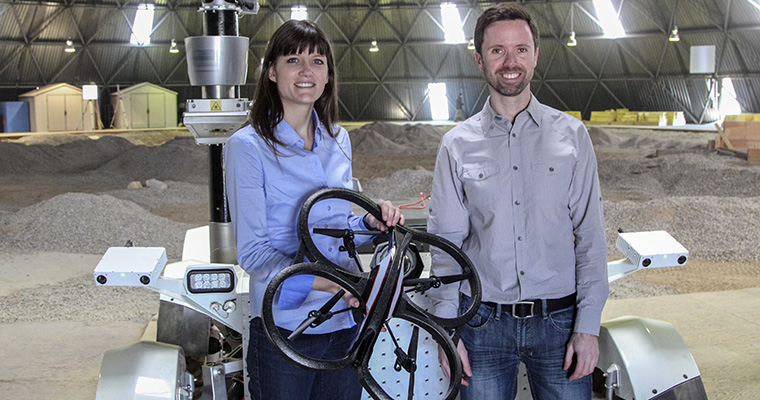 Professors Angela Schoellig and Tim Barfoot with a drone