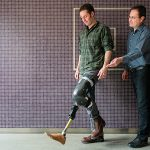 Professor Jan Andrysek and a grad student demonstrate a lower-limb prosthetic device.