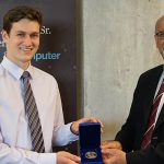 Sandro Young accepting Governor General's Silver Medal from Professor Farid Najm