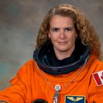 Julie Payette poses in her space suit