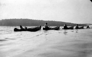 campers on canoes