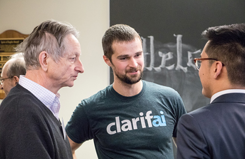 Left to right: U of T Professor Geoff Hinton (Computer Science) and alumnus Matt Zeiler (EngSci 0T9) speak with Kyle Hsu (Year 3 EngSci) at the Engineering Science Education Conference, held January 26, 2018.