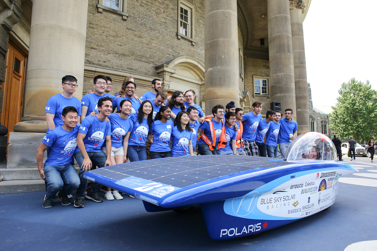 The Blue Sky Solar Racing Team pose with their vehicle